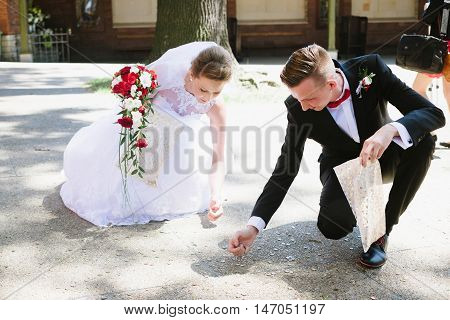 Newlyweds Collects Coins Thrown By The Wedding Guests.