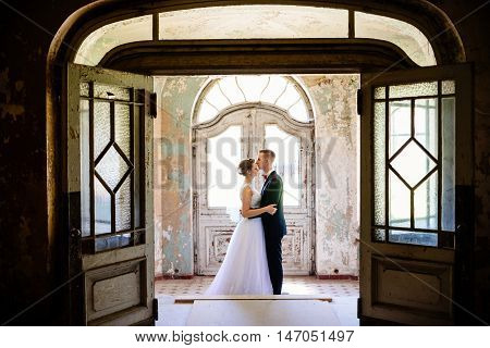 Newlyweds Hugging At The Door In An Old House