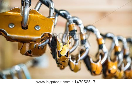 carabiners for climbers hung on a rope closeup