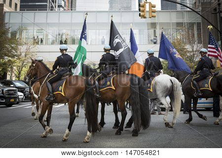 NEW YORK - SEPT 9 2016: Honor Guard on horses from the NYPD present colors in front of the NYPD Emerald Society Pipe and Drums 9/11 Memorial Procession on the 15th anniversary of the terror attacks.