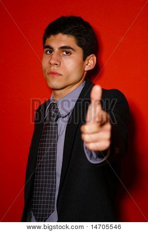Handsome Young man in suit over red wall