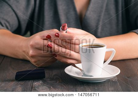 Woman Ready To Rouge Lip After Espresso Coffee