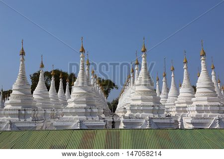 Large stupa forest of the Sandamuni Paya pagoda in Mandalay, Myanmar (Burma)