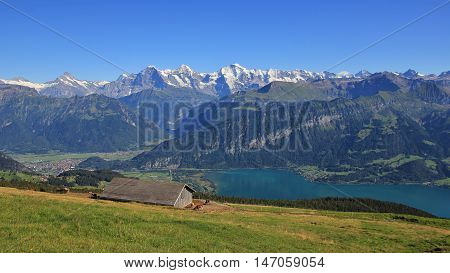 View from Mt Niederhorn Bernese Oberland. Lake Thunersee. Mt Eiger Monch and Jungfrau. Summer scene.