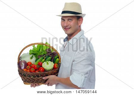 basket with vegetables in farmer's hands on a white background