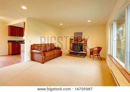 Living Room With Brown Sofa And Fireplace