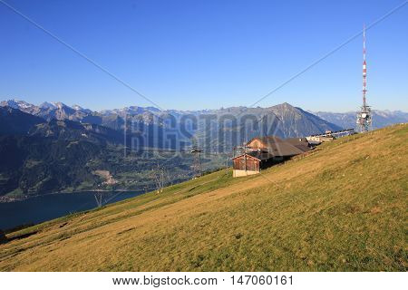 Popular travel destination Mt Niederhorn Swiss Alps. Summit. Distant view of Mt Niesen.