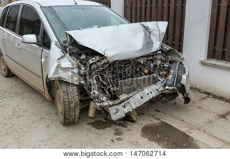 Car wreck from a head on collision with the motor area destroyed