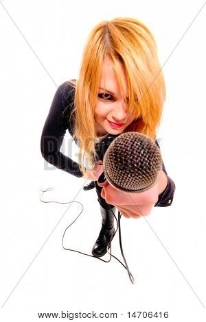 Portrait of female rock singer with microphone in hand