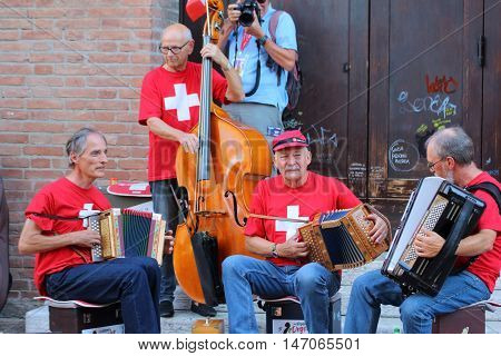 Ferrara, Italia - August 25, 2016: The Ferrara Buskers Festival is dedicated to the art of the street. Airportogeler, a band consists of 4 musicians and serving alpine music.