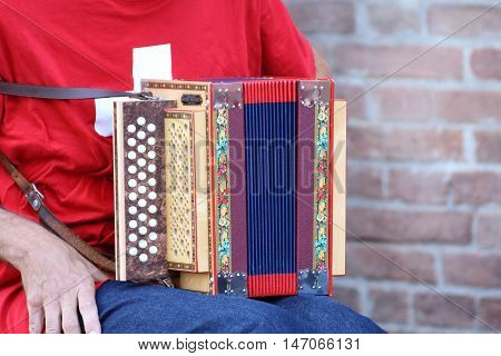Ferrara, Italia - August 25, 2016: The Ferrara Buskers Festival is dedicated to the art of the street. A small detail of a Gwerder accordion used by a street band