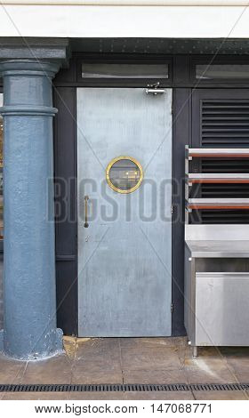 Silver Metal Door With Small Round Window