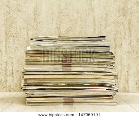 a large stack of magazines close-up front view. tinted photo