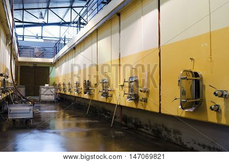 Stainless steel fermentation vessels. Cleaning the floor