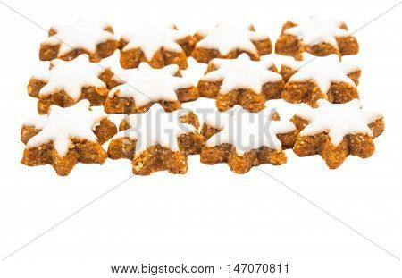 Christmas star shaped cookie with white icing isolated on white