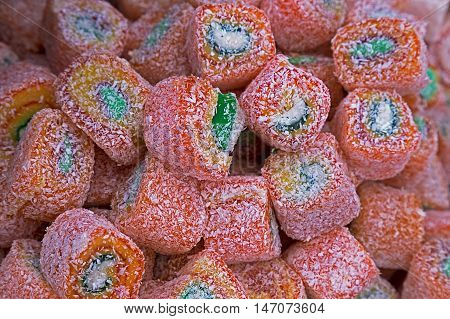 Multicolored sweets rolled presented in bulk (vrac)