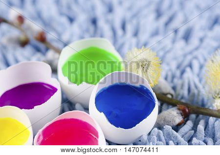 Easter decoration with egg shells and filled with tempera paints
