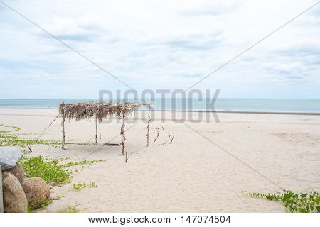 lonely straw shed in clearly sand beach