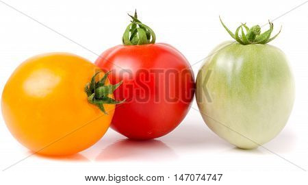 red yellow and green tomatoes isolated on white background.