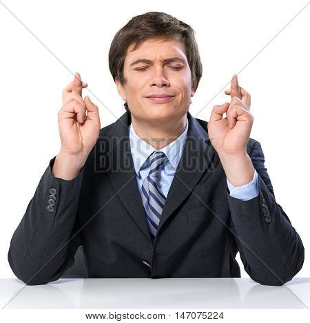 Wishing Businessman Crossing his Fingers - Isolated