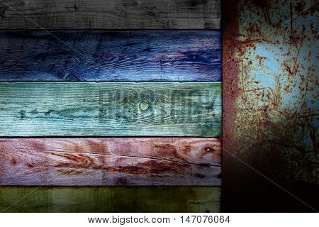 Wooden colors board with end old metal rusty placard