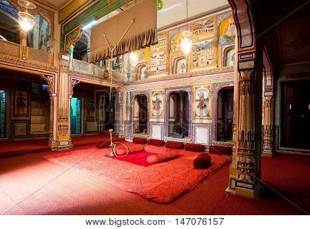 NAWALGARH, INDIA - FEB 6, 2015: Many frescos and old murals inside the Haveli mansion of rich indian family on February 6, 2015. With population of 100000 Nawalgarh is education center of Shekhawati region