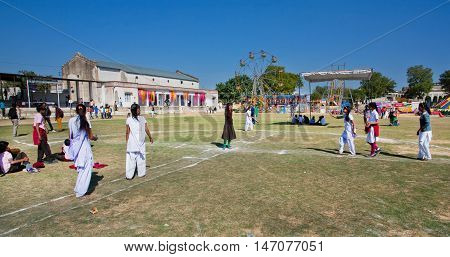 NAWALGARH, INDIA - FEB 6, 2015: Unidentified schoolgirls playing outside the indian village school on February 6, 2015 in Rajasthan. With popul. of 100000 Nawalgarh is education center of Shekhawati area