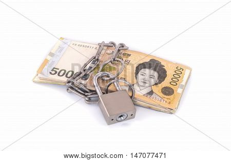 Won bank notes with a lock and chain. Money stack for safety and investment