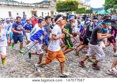 Antigua Guatemala - September 14 2015: Locals run with torch in front of cathedral during Guatemalan Independence Day celebrations