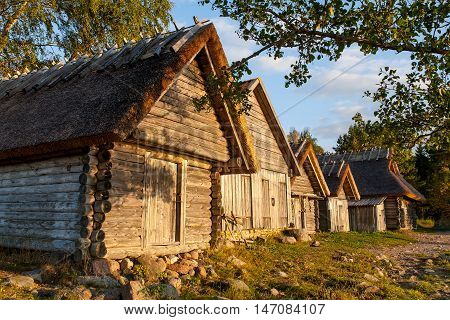 Old wooden boathouse at sunset light in nature. Natural environment background. Altja Lahemaa Estonia Europe