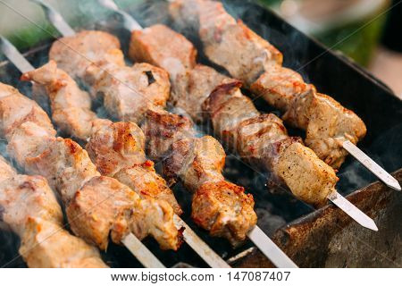 Grilled Marinated Caucasus Barbecue Meat Shashlik Shish Kebab Pork Meat Grilling On Metal Skewer. Nobody