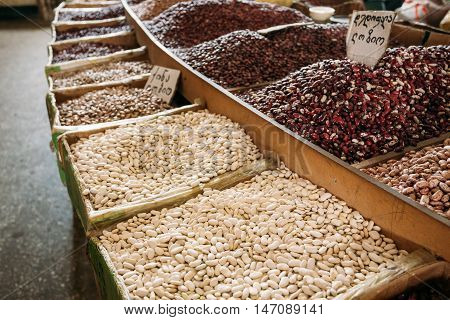 The Diversity Of Varicolored Sorts Of Raw Dry Beans In Bulk In Wooden Trays For Sale At Showcase Of Market, Bazar.