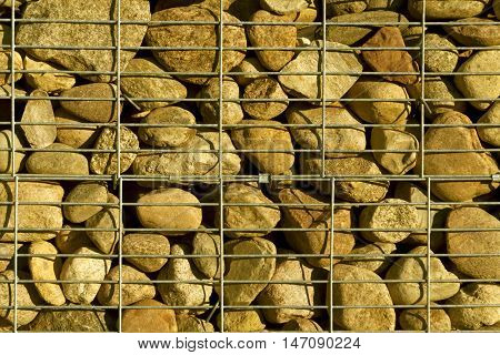 Pile Of Stone With Metal Grid.