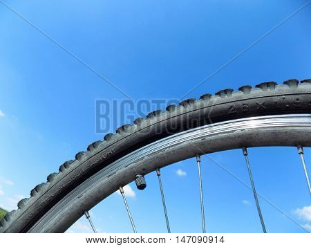 Mountain bike wheel and blue sky during day