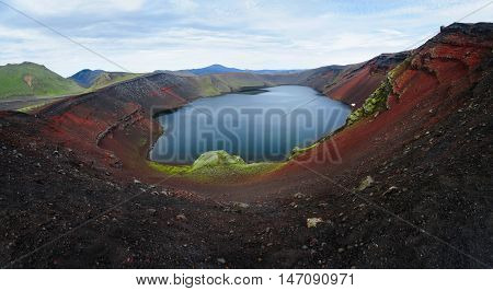Panoramic view of Ljotipollur crater filled with turquoise lake in Landmannalaugar National Park, Iceland