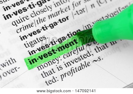 Close Up of Highlighting Specific Word Investment in a Dictionary