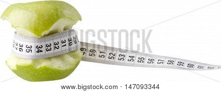 Partially eaten apple with a measuring tape - weight loss concept