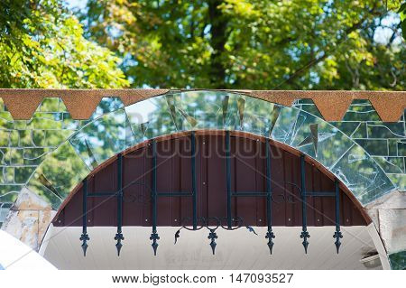 mirror arch on the gate with metal bars.
