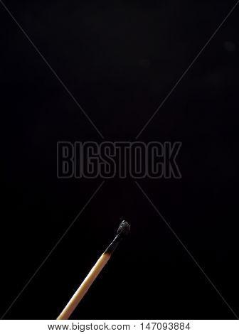 Stewed Match Against A Dark Background