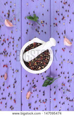 Colorful Pepper In White Mortar On Purple Boards