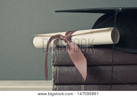 Graduation Cap, Scroll And Books - Faded Tones