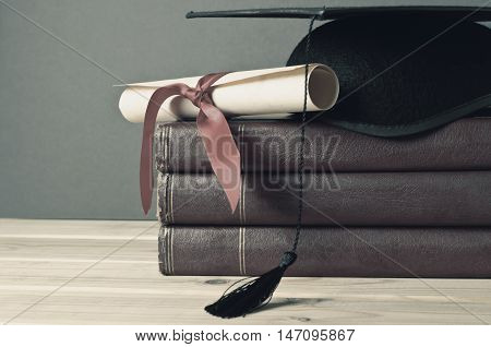 Graduation Mortarboard, Scroll And Books - Faded Tones