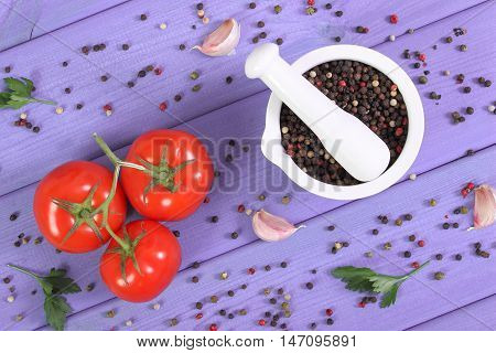 Colorful Pepper In Mortar And Vegetables On Purple Boards
