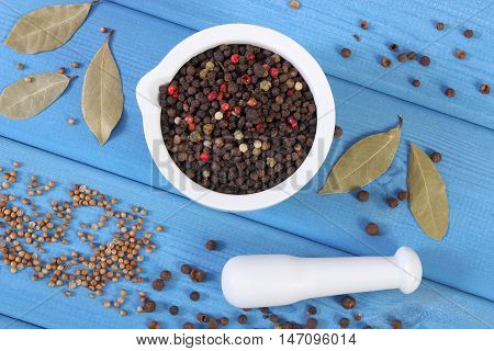 Colorful Pepper In Mortar And Spices On Blue Boards
