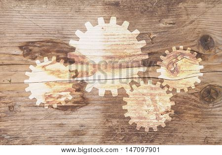 Illustration of gears at brown wooden background