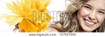 beauty closeup portrait of attractive  caucasian smiling woman  isolated on white studio shot lips toothy smile face hair looking at camera teeth hand holding yellow marple autumn leaves