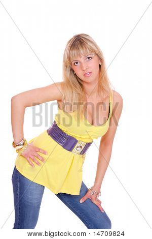Beautiful young woman wearing a yellow shirt. Isolated over white background