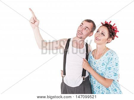 Funny Family Couple Embracing And Pointing Up