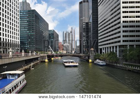 CHICAGO, ILLINOIS - SEPTEMBER 5, 2016: Tour Boat Chicago River. Tourists take the tours of the city via the boat to explore its famous architecture.