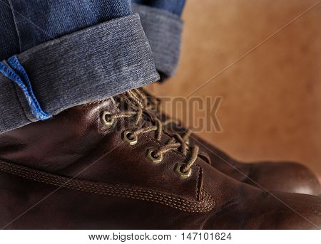 the old leather shoes brown color with blue jeans.